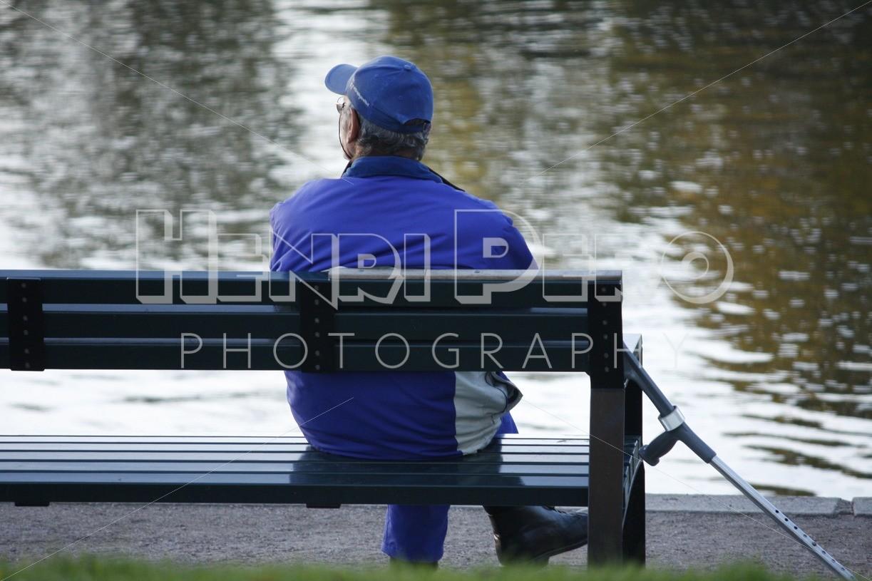 Elderly Man Sitting on a Bench - Henri Pero Photography