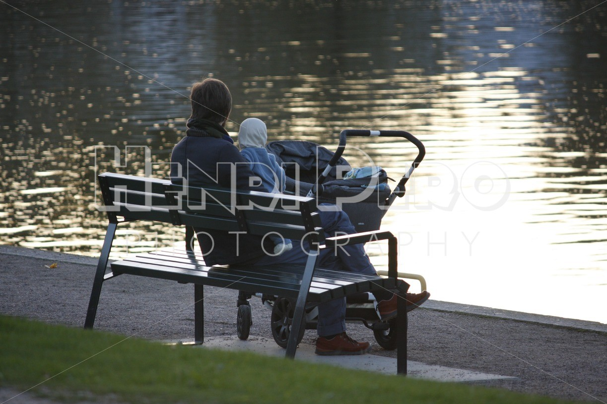 Young Parent Sitting on a Bench with a Baby - Henri Pero Photography