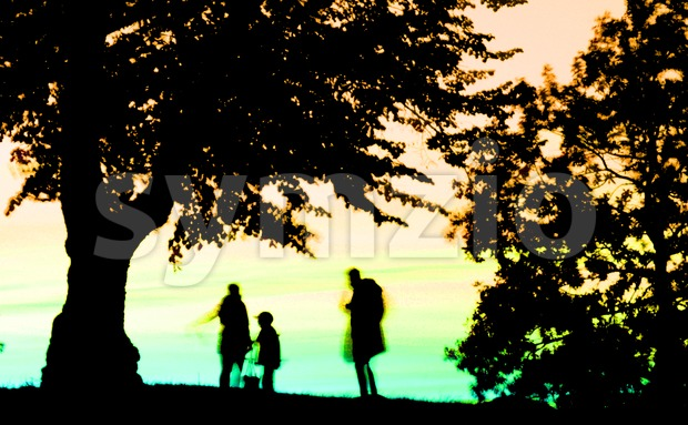 Family Watching Sunset Stock Photo
