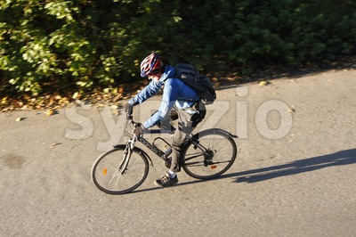 Cyclist Driving on the Road Stock Photo