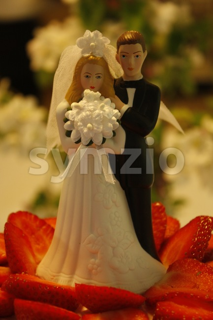 Wedding Cake with Couple Stock Photo