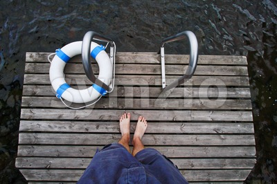 Boy Standing on the Dock Stock Photo