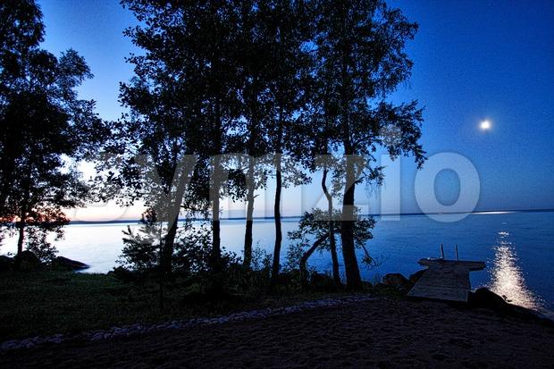 Moonlight and Sunset in Pyhäjärvi Stock Photo