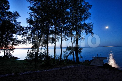 Moonlight and Sunset in Pyhäjärvi Stock Photo