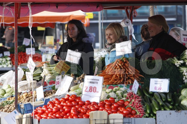 Merchants are selling Finnish vegetables, such as tomatoes, carrots and cucumbers, in the Hakaniemi Market Square in Helsinki, Finland.