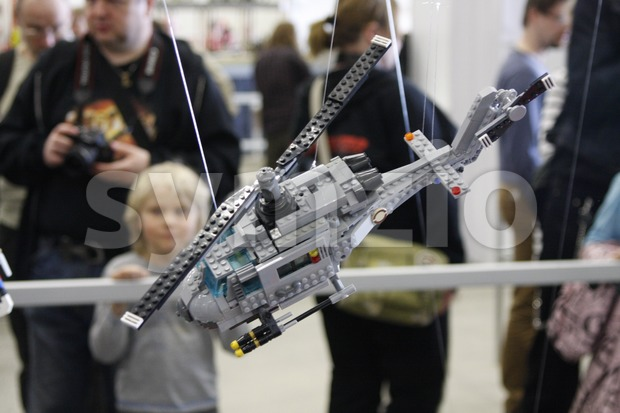 Lego helicopter and people on the background in the Model Expo 2014. The Model Expo is the biggest scale model ...