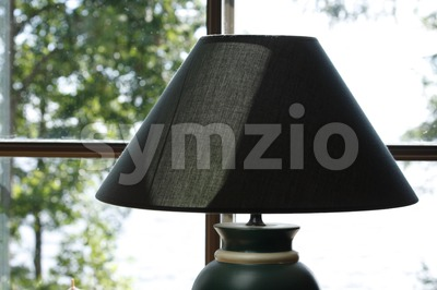 Lamp in Front of Window Stock Photo